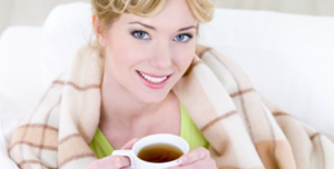 woman client enjoys her tea, in her warm home
