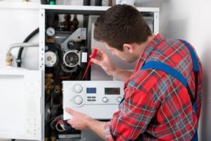 Heater repairman fixing heating system